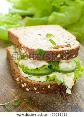 Healthy sandwich with fresh cucumber and egg for breakfast