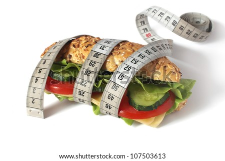 healthy sandwich with fresh vegetable and cheese and measuring t