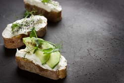 Healthy sandwiches with avocado , cream cheese and micro green. Vegan sandwiches, vegan food, healthy eating. Template with space for text , black background