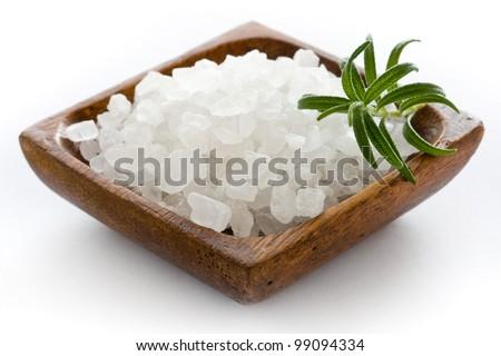 Healthy sea salt in wooden bowl closeup
