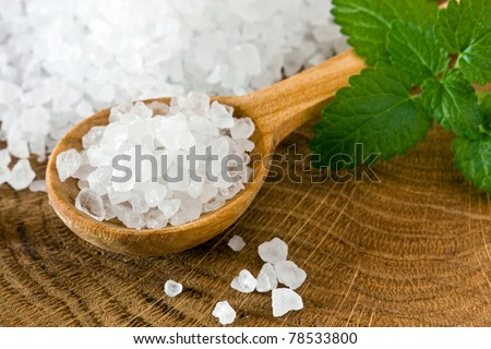 Healthy sea salt on wooden spoon closeup
