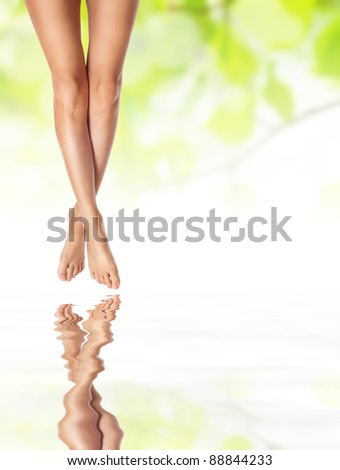 healthy sexy slender female legs on water - spa and healthcare concept - stock photo
