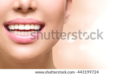 Healthy Smile. Teeth Whitening. Dental care Concept. Woman Smile Closeup. Beautiful Lips and Teeth over white background