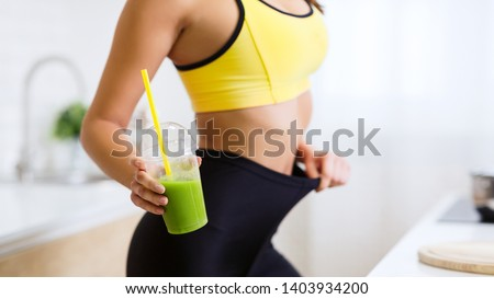 Healthy Smoothie. Fit Girl In Oversize Pants Holding Detox Smoothie