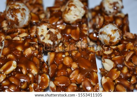 Healthy Snack bites made of Jaggery Groundnut and Makkhana. Groundnut chikki burfi famous snack in India.