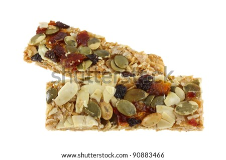 Healthy Snack: Cereal Bars germinate rice whole grains with fruits, isolated on white - stock photo