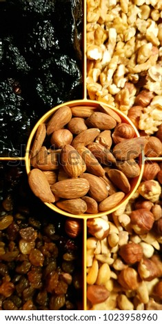 Healthy snack nuts, walnut, almond,hazelnut,  peanuts, cranberry, Raisins, plum #1023958960