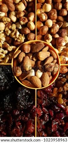 Healthy snack nuts, walnut, almond,hazelnut,  peanuts, cranberry, Raisins, plum #1023958963