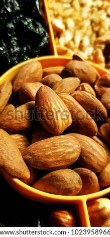 Healthy snack nuts, walnut, almond,hazelnut,  peanuts, cranberry, Raisins, plum #1023958966