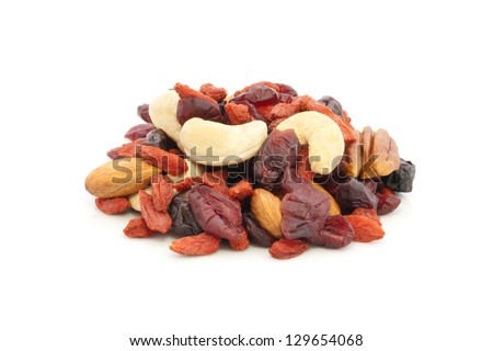 Healthy snack of dried fruits on white background.