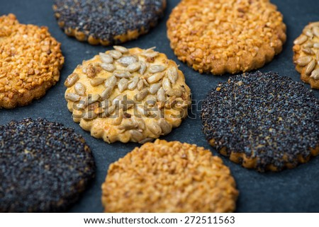 Healthy snacks with seeds, food background from above