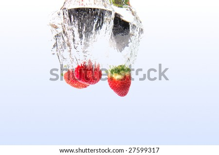 healthy strawberry fruits splashing in cool water
