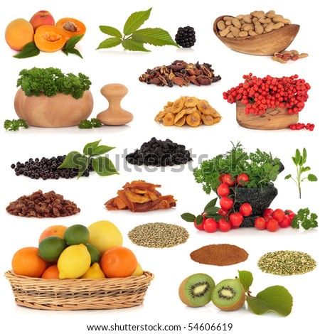 Healthy super food collection of fresh and dried fruit, nuts, herbs, spices, and pulses, very high in antioxidants and vitamins, isolated over white background.