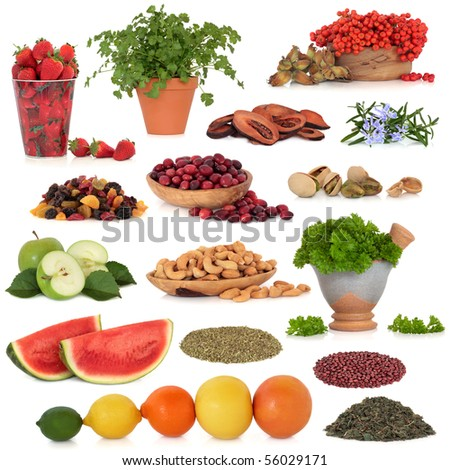 Healthy super food collection of fruit, herbs, pulses and nuts, very high in antioxidants and vitamins, isolated over white background.