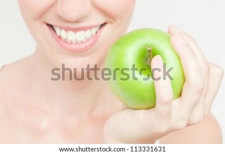 Healthy Teeth And Green Apple