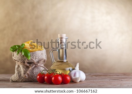 Healthy traditional food concept with pasta and other  ingredients on old wooden table - copyspace