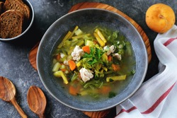 Healthy turnip soup with chicken breast, cabbage, carrots and tomato.