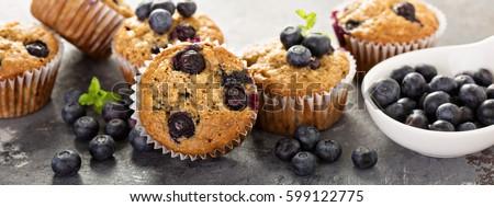 Healthy vegan banana blueberry muffins with fresh berries