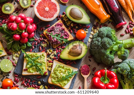 Healthy vegan food. Fresh vegetables on wooden background. Detox diet. Different colorful fresh juices. #611209640