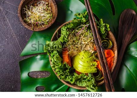 Healthy vegan lunch in a coconut bowl. Buddha bowl on a dark background. #1457612726