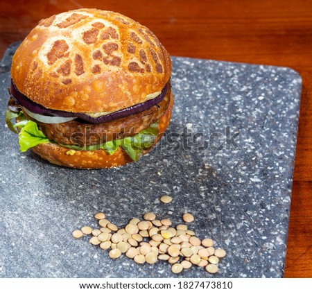 Healthy vegan or vegetarian fast food, fresh made plant based burgers with vegetables close up Foto d'archivio ©