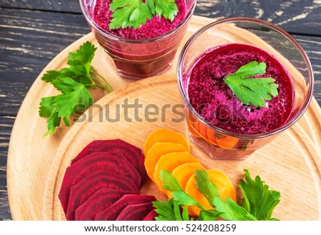Healthy vegetable smoothie in a glass mug and ingredients on rustic wooden background