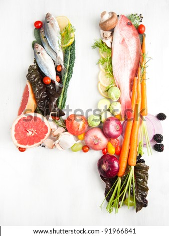 Healthy Vegetables, Meats, Fruit and Fish Shaped in Number Four 4
