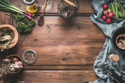 Healthy vegetarian eating and home cooking concept. Vegan ingredients on rustic wooden table with herbs and spices. Top view. Paleo dieting. Place for text