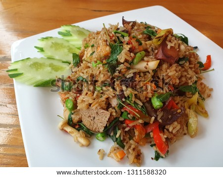 Healthy vegetarian foods A vegetarian menu of fried rice with holy basil, put vegetables and tofu.  No meat ingredients  #1311588320