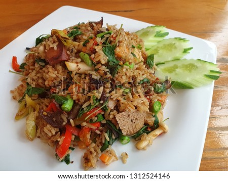 Healthy vegetarian foods A vegetarian menu of fried rice with holy basil, put vegetables and tofu.  No meat ingredients