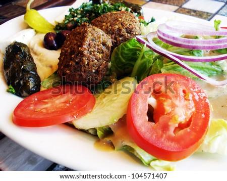 Healthy vegetarian lunch or dinner of greek salad hummus dolma and falafel mediterranean - Healthy greek recipes for dinner mediterranean savour ...