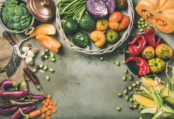 Healthy vegetarian seasonal Fall food cooking background. Flat-lay of Autumn vegetables from local market over grey concrete table background, top view, copy space. Vegan, dieting, alkaline diet food