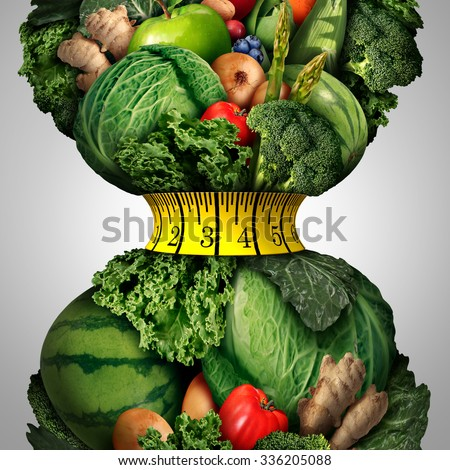 Healthy weight loss diet as a group of fresh fruits and vegetables with a fitness tape measure wrapped around a tight shrinking waistline shape as a metaphor for healthy lifestyle weightloss.