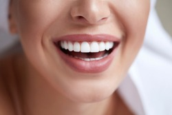 Healthy white smile close up. Beauty woman with perfect smile, lips and teeth. Beautiful Model Girl with perfect skin. Teeth whitening.