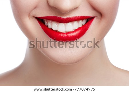 Healthy white smile close up. Beauty woman with perfect smile, lips and white teeth. Beautiful Model Girl with red lips isolated on white background. Teeth whitening and cleaning, dental care. #777074995