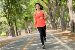 Healthy woman are running in the park in the morning. She smiled and enjoyed.