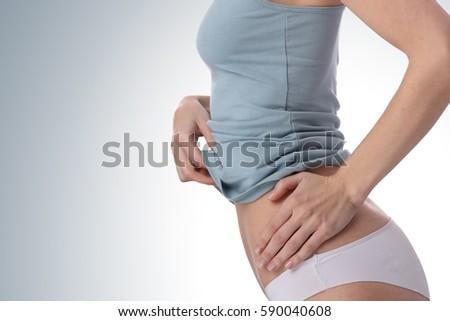 Shutterstock Healthy woman body, waistline. Slim female torso, waist, belly, abdomen close up. Sport, fitness, Dieting results, laser lipolysis, active lifestyle concept