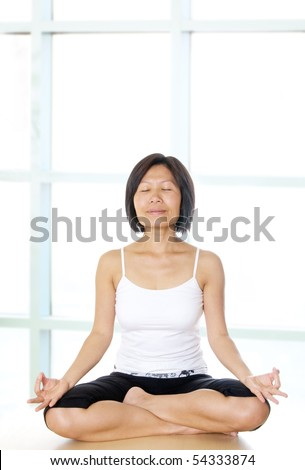 Healthy woman practicing her yoga