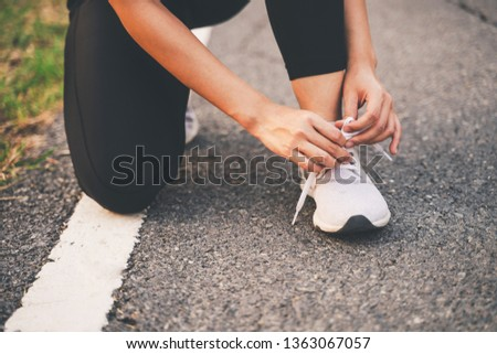 Healthy woman runner legs running exercise jogging on road, Woman fitness jog workout in the park during sunset #1363067057