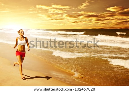 Healthy woman running on the beach, girl doing sport outdoor, happy female exercising, freedom, vacation, fitness and heath care concept with copy space over natural warm sunset background