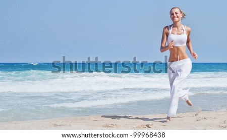 Healthy woman running on the beach, girl doing sport outdoor, happy female exercising, freedom, vacation, fitness and heath care concept with copy space over natural background - stock photo