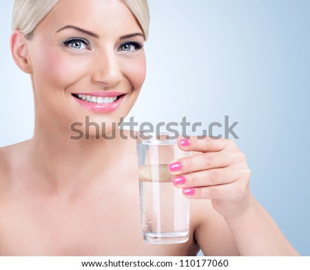 Healthy woman with glass of water