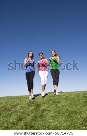 Healthy Women Jogging Together Outdoors