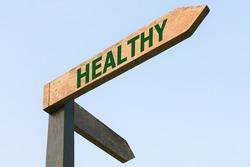 HEALTHY word on wood roadsign