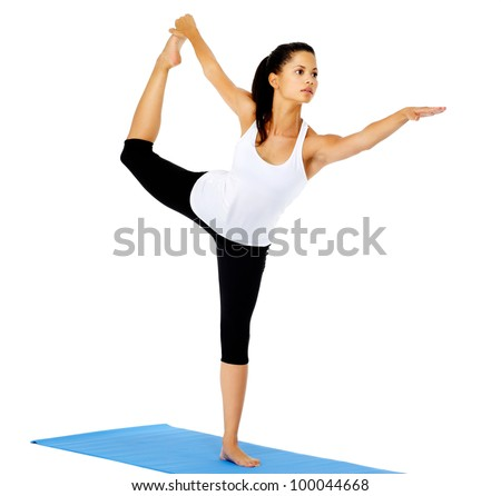 Healthy yoga woman does stretch on mat. This is part of a series of various yoga poses by this model, isolated on white