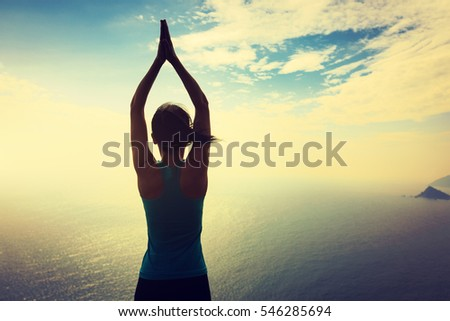healthy yoga woman meditation at sunrise seaside