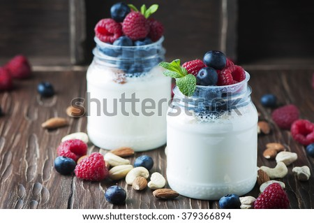 Healthy yogurt with belly and nuts, selective focus