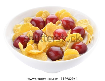 Healthy yogurt with corn flakes and cherries served in a bowl
