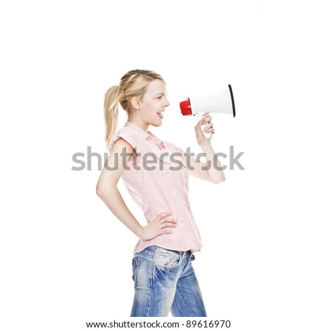 healthy young blonde attractive woman shouts in a bullhorn