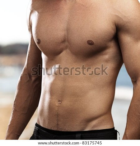 healthy young man against a beach background